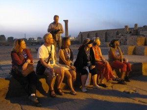 Baby boomers listen to an archaeologist talk about the ruins at Kom Ombo in Egypt