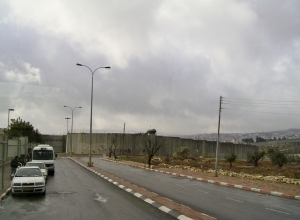 "Approaching the ""Separation Wall"" (a.k.a. the West Bank Wall) where visitors must stop to change vehicles before entering Bethlehem."
